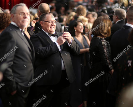 John Lasseter arrives at the Oscars, at the Dolby Theatre in Los Angeles