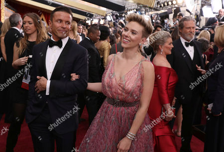Scarlett Johansson, right, and Joe Machota arrive at the Oscars, at the Dolby Theatre in Los Angeles