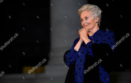 "Lee Meriwether, who played Catwoman in ""Batman: The Movie,"" watches during a tribute to ""Batman"" star Adam West that included lighting a Bat-Signal at City Hall, in Los Angeles"