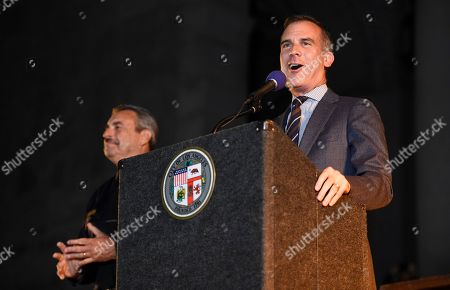 "Los Angeles Mayor Eric Garcetti speaks as Los Angeles Police Chief Charlie Beck looks on at a tribute to ""Batman"" star Adam West that includes lighting a Bat-Signal at City Hall, in Los Angeles"