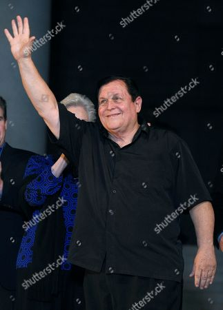 "Burt Ward, who co-starred in the ""Batman"" television series, waves to fans during a tribute to Adam West that included lighting a Bat-Signal at City Hall, in Los Angeles"
