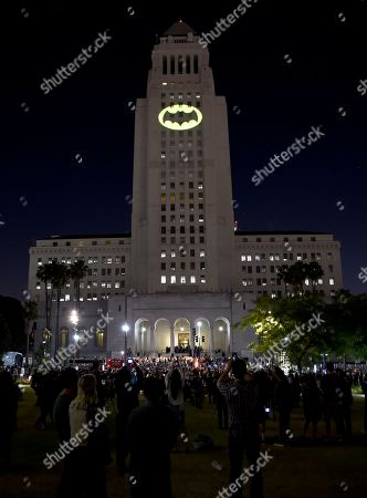 "Fans gather as a Bat-Signal is projected onto City Hall during a tribute to ""Batman"" star Adam West, in Los Angeles"
