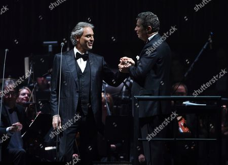 Singer Andrea Bocelli, left, performs with conductor Eugene Kohn and the Philharmonia Orchestra of New York at Madison Square Garden, in New York