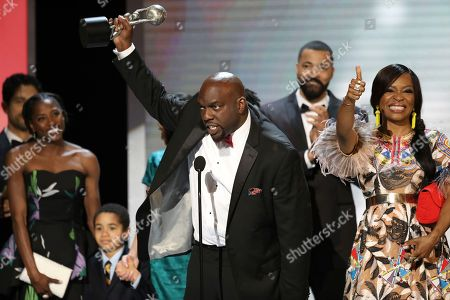 """Omar J. Dorsey, center, and the cast and crew of """"Queen Sugar"""" accept the award for outstanding drama series at the 48th annual NAACP Image Awards at the Pasadena Civic Auditorium, in Pasadena, Calif"""