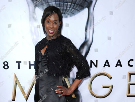"""Margot Lee Shetterly arrives at the 48th annual NAACP Image Awards at the Pasadena Civic Auditorium in Pasadena, Calif. Sheerly, whose book was the basis for the Oscar-nominated movie """"Hidden Figures,"""" has won an award for writing literature that promotes diversity and confronts racism. Shetterly and Isabel Allende were among five winners of the Anisfield-Wolf Book Awards announced"""