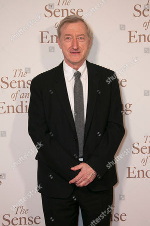 Stock Image of Writer Julian Barnes poses for photographers as he arrives for the UK Gala screening of The Sense of an Ending at a central London cinema