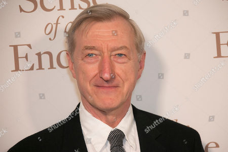 Writer Julian Barnes poses for photographers as he arrives for the UK Gala screening of The Sense of an Ending at a central London cinema