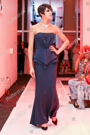 """Stock Picture of Model, Arisce Wanzer, walks the runway at the AIDS Healthcare Foundation's International Condom Day """"Always in Fashion!"""" event at South Park Center, in Los Angeles"""