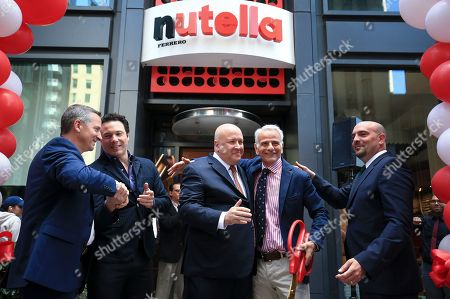 L-R) Rick Fossali, head of operations, Nutella Cafe, Nutella® fan Rocco DiSpirito, Paul Chibe, President and CEO, Ferrero North America, Daniele Bondi, Global President of Food Service for Ferrero, and Noah Szporn, head of marketing, Nutella North America, after the ribbon cutting to officially open Nutella Cafe on in Chicago, Ill