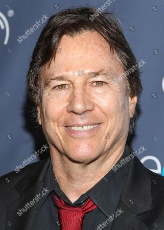 """Actor Richard Hatch arrives at the 2013 Geekie Awards at the Avalon in Los Angeles. Hatch, perhaps best known for playing Captain Apollo in the original """"Battlestar Galactica"""" film and TV series, has died at age 71. A representative for the actor says Hatch died Tuesday afternoon, Feb. 7, 2017, after a battle with pancreatic cancer"""