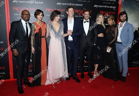 """Fraser James, from left, Ruby Rose, Milla Jovovich, writer/director Paul W. S. Anderson, William Levy, Ali Larter, Rola and Eoin Macken arrive at the world premiere of """"Resident Evil: The Final Chapter"""" at Regal L.A. Live, in Los Angeles"""