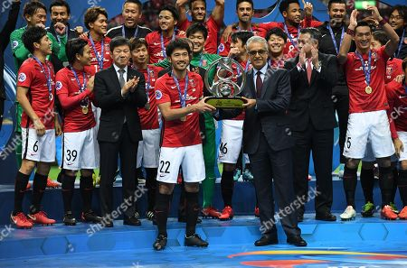 Yuki Abe of Urawa Reds receives the trophy from AFC president Shaikh Salman bin Ebrahim Al Khalifa after winning the AFC Champions League Final 2nd leg match