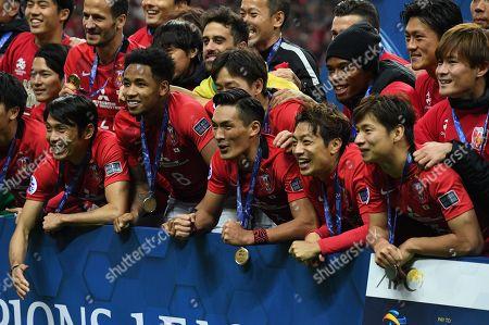 Ryota Moriwaki, Rafael da Silva, Tomoaki Makino, Tsukasa Umesaki and Kazuki Nagasawa of Urawa Reds celebrate after winning the AFC Champions League Final 2nd leg match