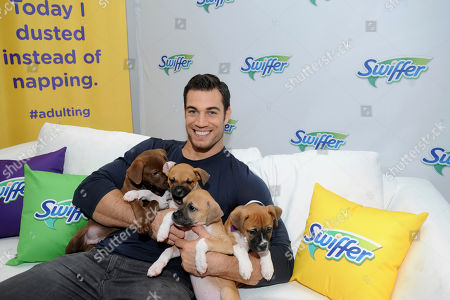 """Hot Vet"""" Dr. Evan Antin shows some puppy love as he partners with Swiffer to demonstrate the joys of new pet ownership with the help of Bideawee Animal Shelter, in New York. Swiffer helps create a safe and clean home for your new pet"""
