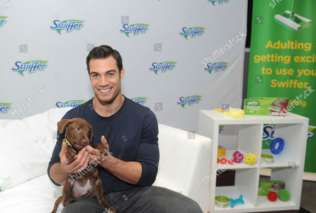 """Dr. Evan Antin helps Swiffer celebrate the upcoming National Pet Month (May), in New York, with the help of Bideawee Animal Shelter puppies. Swiffer and the """"Hot Vet"""" share their adulting tips for creating a clean, safe home for new pets"""