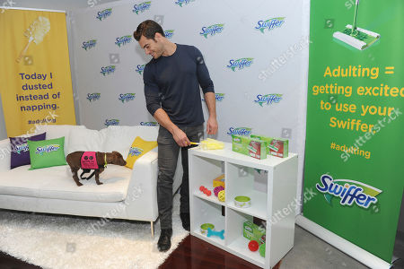 Instagram's favorite pet vet, Dr. Evan Antin, spends the day with Swiffer helping new pet owners nail the adulting moments of pet parenthood with pet-friendly solutions for creating a clean and safe home, in New York. His puppy companion is an adoptable pup from Bideawee Animal Shelter
