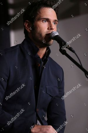 """Artist Chuck Wicks speaks at a press conference before the """"1 Night. 1 Place. 1 Time.: A Heroes and Friends Tribute to Randy Travis"""" at Bridgestone Arena on in Nashville, Tenn"""