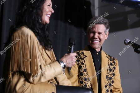 """From left, Mary Travis and artist Randy Travis speak at a press conference before """"1 Night. 1 Place. 1 Time.: A Heroes and Friends Tribute to Randy Travis"""" at Bridgestone Arena, in Nashville, Tenn"""
