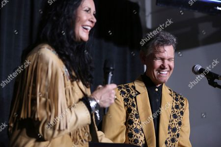 """From left, Mary Travis and artist Randy Travis speak at a press conference before the """"1 Night. 1 Place. 1 Time.: A Heroes and Friends Tribute to Randy Travis"""" at Bridgestone Arena on in Nashville, Tenn"""