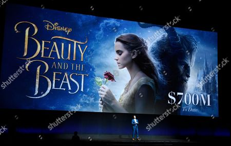 """Dave Hollis, executive vice president of theatrical exhibition sales and distribution for Walt Disney Studios, speaks about the box office performance of their film """"Beauty and the Beast"""" during their presentation at CinemaCon 2017 at Caesars Palace, in Las Vegas"""