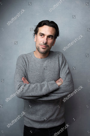 "Stock Image of Director Alexandre Moors poses for a portrait to promote the film, ""The Yellow Birds"", at the Music Lodge during the Sundance Film Festival, in Park City, Utah"