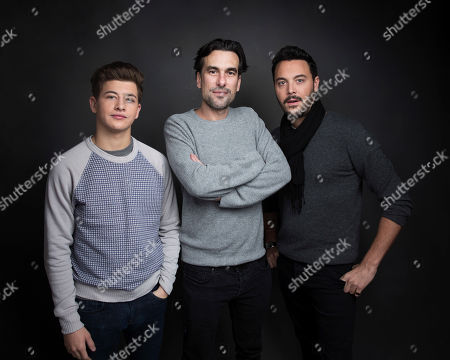 "Actor Tye Sheridan, from left, director Alexandre Moors and actor Jack Huston pose for a portrait to promote the film, ""The Yellow Birds"", at the Music Lodge during the Sundance Film Festival, in Park City, Utah"