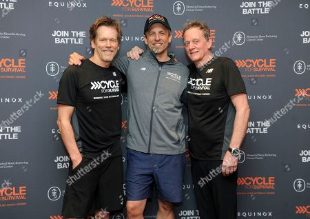 Kevin Bacon, left, and Michael Bacon, right, The Bacon Brothers, with Seth Meyers, center, show their support for the movement to beat rare cancers at a Cycle for Survival event in New York