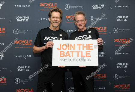 Kevin Bacon, left, and Michael Bacon, The Bacon Brothers, join rare cancer survivors, patients, caregivers, doctors and supporters at a Cycle for Survival event in New York, . The indoor cycling rides take place across the country to raise funds for rare cancer research led by Memorial Sloan Kettering Cancer Center