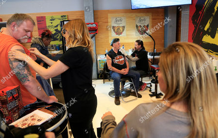Ink Master's Oliver Peck gives complimentary tattoos at the Sailor Jerry Spiced Rum and Harley-Davidson launch event celebrating custom artist motorcycles collaborations at Harley-Davidson Museum on Tuesday May, 2, 2017, in Milwaukee, WI