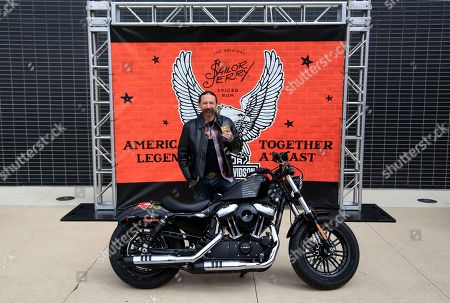 Stock Photo of Artist Oliver Peck shows off his custom bike for the collaboration at the Sailor Jerry Spiced Rum and Harley-Davidson launch of the custom artist motorcycles collaboration at Harley-Davidson Museum, in Milwaukee