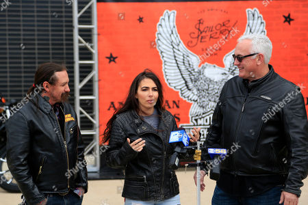 Ashley Marsh, center, brand ambassador of Sailor Jerry Spiced Rum and ink masters' Oliver Peck, left, and Scott Back director of Marketing for Harley-Davidson unveil the motorcycles at the Sailor Jerry Spiced Rum and Harley-Davidson launch with custom artist motorcycles collaboration at Harley-Davidson Museum, in Milwaukee