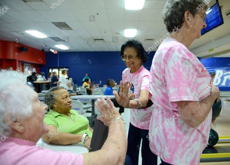 Stock Picture of National Senior Games bowler Rose Roylo, 88, center, celebrates with, from left, Frances Coltrane, Alice Walker, and Beverly Moss at the 2017 National Senior Games presented by Humana at Brunswick Zone Riverview Lanes, in Birmingham, Ala