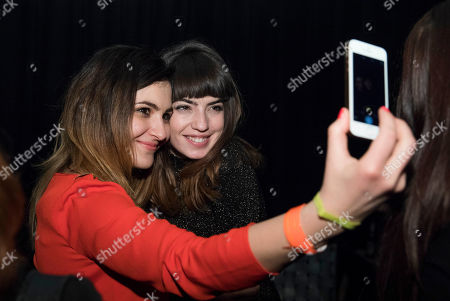 Stock Image of Bulgarian actress Anjela Nedyalkova, right, poses with a fan for a snapshot at a rave hosted by Sony Pictures and Boiler Room to celebrate the T2: Trainspotting premiere at the Berlin Film Festival at Prince Charles, in Berlin