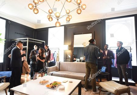 Guests enjoy a new fitting room created by designer Zachary Prell at Trunk Club's New York Clubhouse, . Trunk Club is a personal styling service for men and women
