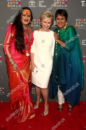 Laxmi Narayan Tripathi, from left, Tina Brown and Barkha Dutt attend the opening night of the 8th Annual Women in the World Summit at the David H. Koch Theater, in New York