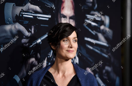 """Stock Image of Actress Carrie-Ann Moss poses at the premiere of the film """"John Wick: Chapter 2,"""" at ArcLight Cinemas, in Los Angeles"""