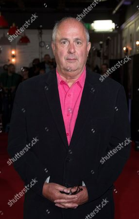 Director Roger Michell poses for photographers upon arrival at the My Cousin Rachel premiere in London