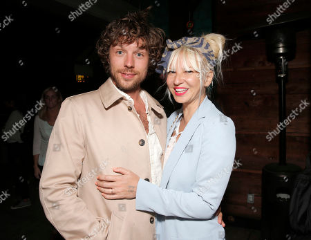 """Filmmaker Erik Anders Lang, left, and singer Sia attend a party after the premiere of """"The One I Love,"""" in Los Angeles. Court records in Los Angeles show Sia filed for divorce from her husband of two years, Lang, on Dec. 20, 2016, citing irreconcilable differences"""