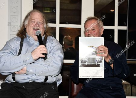 Chef Wolfgang Puck, right, accepts his Gold Award as Los Angeles Times Food Critic Jonathan Gold looks on at the Los Angeles Times Food Bowl Gold Award Party at Spago, in Beverly Hills, Calif