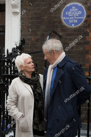 Actress Judi Dench is photographed as she is joined by Sir Ian McKellen after unveiling a blue plaque commemorating Sir John Gielgud in central London, outside the Westminster home where Sir John lived for 31 years, . The blue plaque commemorates famed English actor and director Gielgud whose career spanned eight decades until his death in May 2000