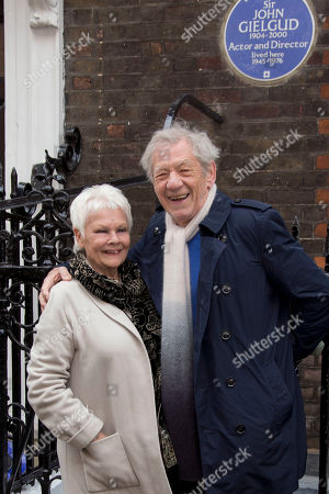 Stock Image of Actress Dame Judi Dench is photographed as she is joined by Sir Ian McKellen after unveiling a blue plaque commemorating Sir John Gielgud in central London, outside the Westminster home where Sir John lived for 31 years, . The blue plaque commemorates famed English actor and director Gielgud whose career spanned eight decades until his death in May 2000