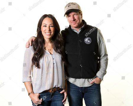 """Joanna Gaines, left, and Chip Gaines pose for a portrait in New York to promote their home improvement show, """"Fixer Upper,"""" on HGTV. Gaines responded on Twitter April 29, 2017, to a lawsuit filed against him by former business partners in Texas"""