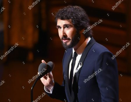 "Shows Josh Groban wearing a silver ribbon as he speaks at the Tony Awards at the Beacon Theatre in New York. One of the more out-of-left field options this fall will be ""Natasha, Pierre & the Great Comet of 1812,"" a sung-through musical that dramatizes a 70-page melodrama at the center of Leo Tolstoy's ""War and Peace."" Groban will star but the transfer to Broadway may be tough. When it was off-Broadway, the show tried to erase the line between audience and performer by offering a full Russian-themed meal and audience members were asked to pass along love letters and interact with actors. How will the show keep its immersive soul"