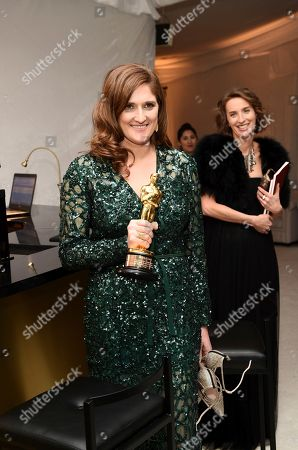 """Caroline Waterlow poses with the award for best documentary feature for """"O.J.: Made in America"""" at the Governors Ball after the Oscars, at the Dolby Theatre in Los Angeles"""