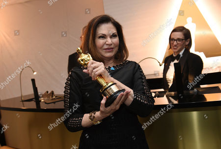 "Colleen Atwood poses with the award for best costume design for ""Fantastic Beasts and Where to Find Them"" at the Governors Ball after the Oscars, at the Dolby Theatre in Los Angeles"