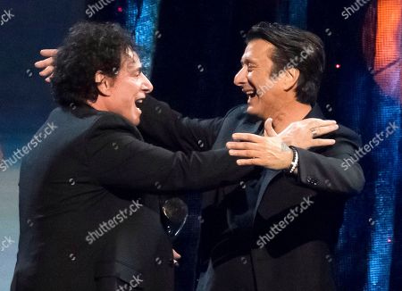 Inductees Neal Schon, left, and Steve Perry from the band Journey embrace at the 2017 Rock and Roll Hall of Fame induction ceremony at the Barclays Center, in New York