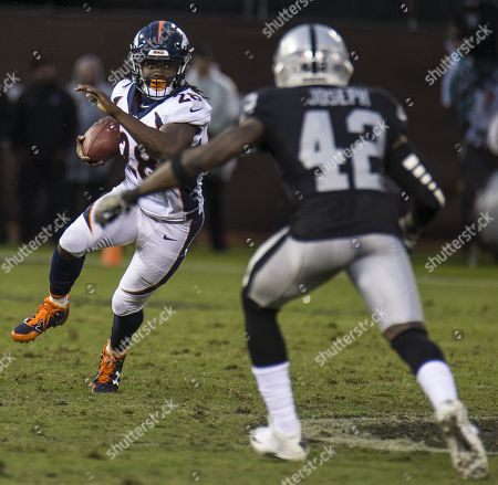 Oakland CA, U.S.A Denver running back Jamaal Charles (28) catch a short yardage pass in front of Oakland strong safety Karl Joseph (42) during the NFL football game between Denver Broncos and the Oakland Raiders 21-14 lost at O.co Coliseum Stadium Oakland Calif. Thurman James / CSM