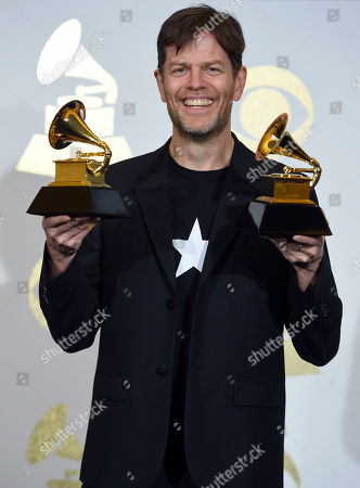 Donny McCaslin poses in the press room with the awards for best alternative music album and best rock performance for â?œBlackstarâ?? at the 59th annual Grammy Awards at the Staples Center, in Los Angeles