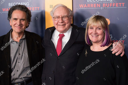 """Stock Image of Peter Buffett, from left, Warren Buffett and Susie Buffett attend the world premiere screening of HBO's """"Becoming Warren Buffett"""" at The Museum of Modern Art in New York. A foundation run by Peter, the youngest son of billionaire investor Warren Buffett, is announcing its strategy for distributing $90 million to help improve the lives of young women and girls of color in the United States. The NoVo Foundation was created in 2006 by Jennifer and Peter Buffett"""