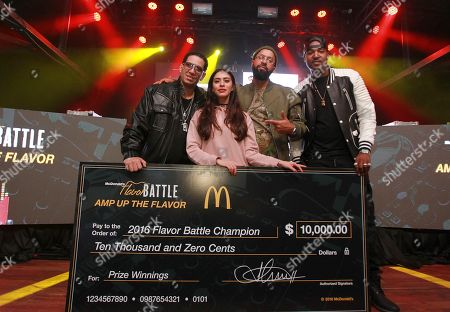 DJ Orange Calderon, second from the left, was crowned the 2016 McDonald's Flavor Battle Champion and was presented a $10,000 check by celebrity judges DJ Kid Capri, left, Kenny Burns, center, and DJ Infamous at the 2016 Flavor Battle Finale at Terminal West, in Atlanta